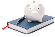 Piggy bank standing on book