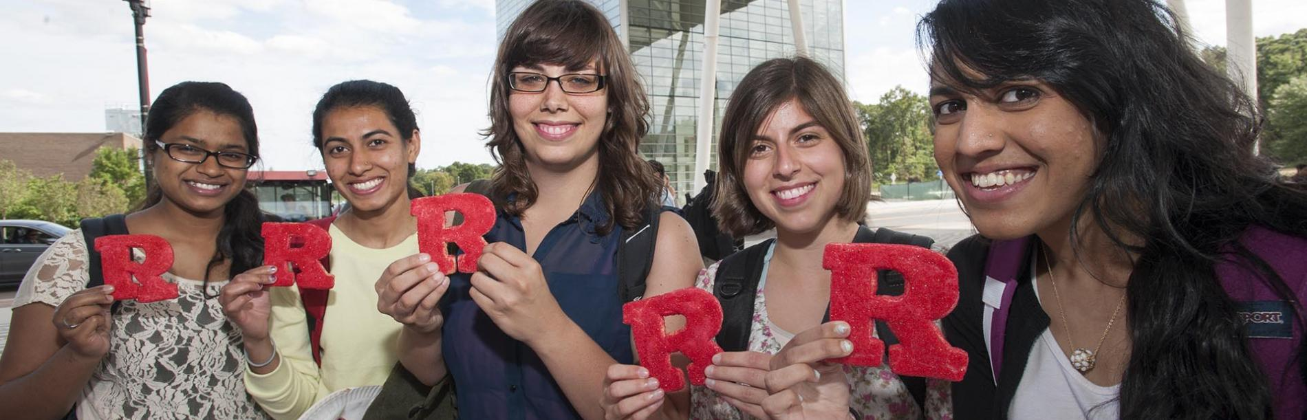 Students holding red Rs