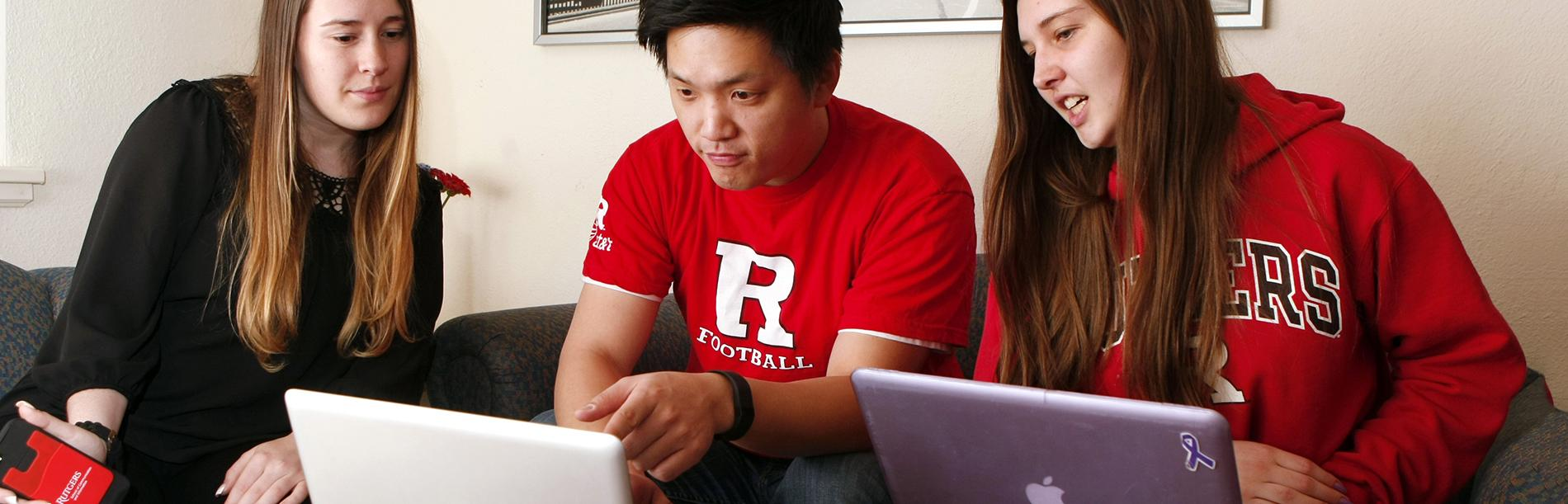 Three students learning wearing Rutgers shirts